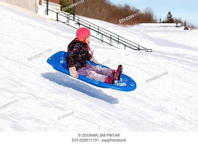 Sledding Girl Flying Down Hill