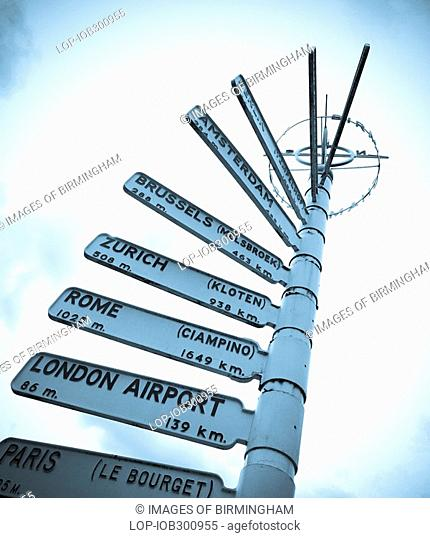England, West Midlands, Birmingham, A fingerpost outside Birmingham International Airport showing directions and distance to important national and...