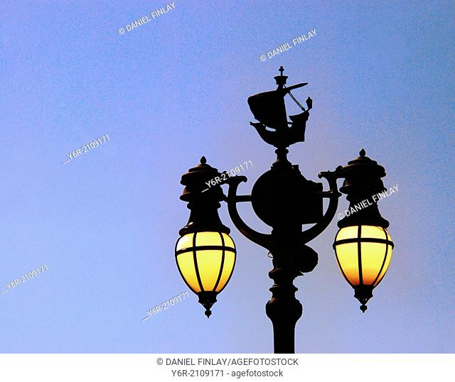 Elaborate street-lamp in the royal quarter in the heart of London, England, at dusk