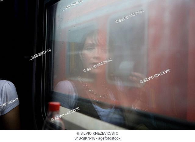Woman in a train compartment