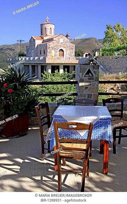 Taverna overlooking the church, mountain village of Axos, Crete, Greece, Europe
