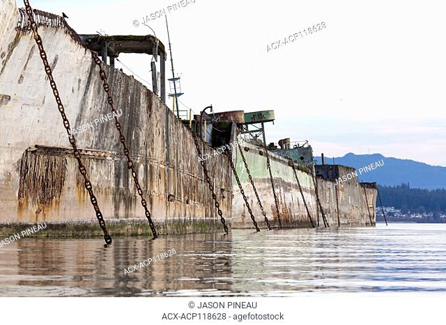 Concrete barges, used as a floating breakwater for Catalyst Paper's Mill in Powell River, British Columbia, Canada