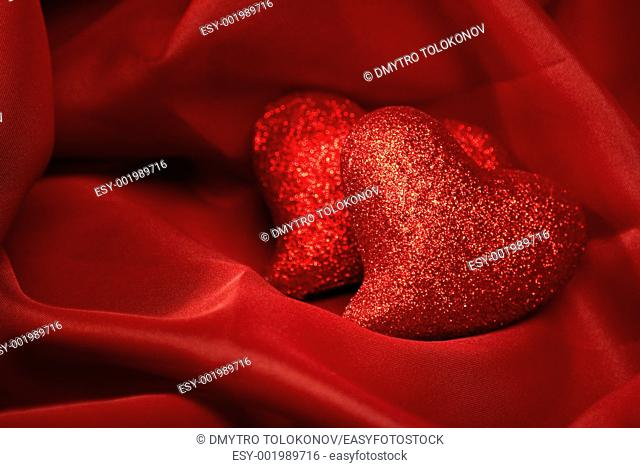 abstract Valentine's backgrounds over red textile with tho hearts