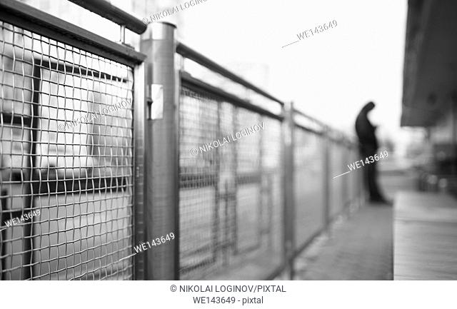 Perspective fence with man in background
