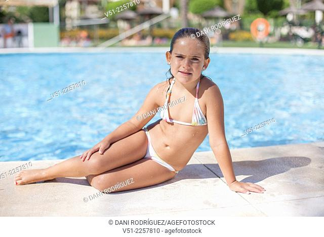 Pretty young girl in swimming pool