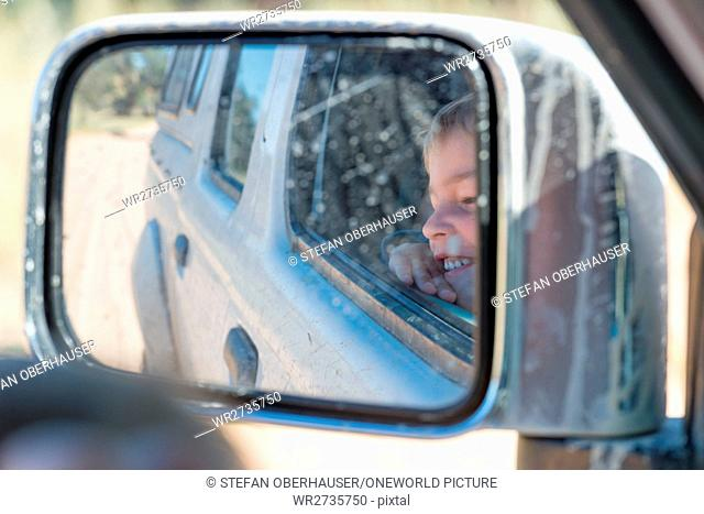 South Africa, North Cape, Benede Oranje, Kgalagadi Transfrontier Park, Little boy in car on animal watching, Safari