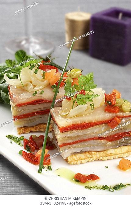 Escalivada roasted sweet peppers and aubergines and smoked cod millefeuille pastry on caramelized puffy pastry