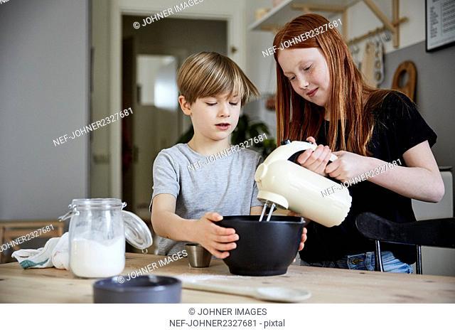 Children using electric mixer