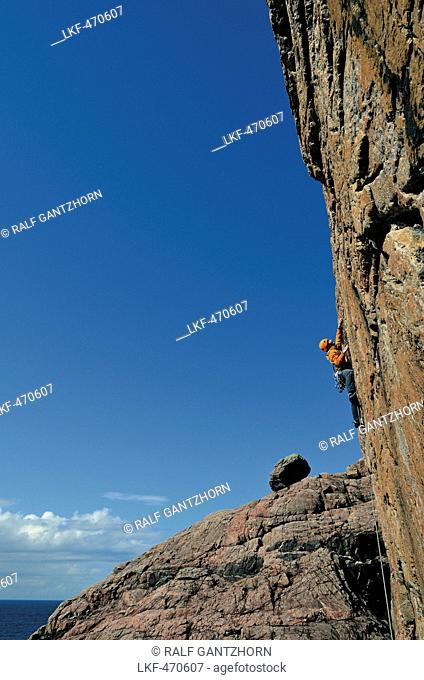 Man climbing in the cliffs of Sheigra, Highlands, Scotland, Great Britain
