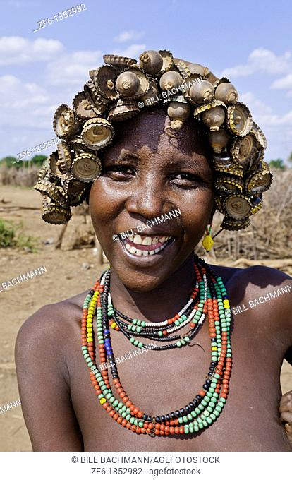 Dassnech Tribe in Omorate Ethiopia Africa Lower Omo Valley wife portrait in village with headress 26