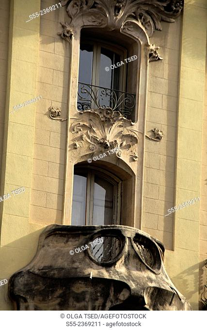 Modernist building detail, close-up of a balcony and two windows. Carrer del Bruc, Barcelona, Catalonia, Spain