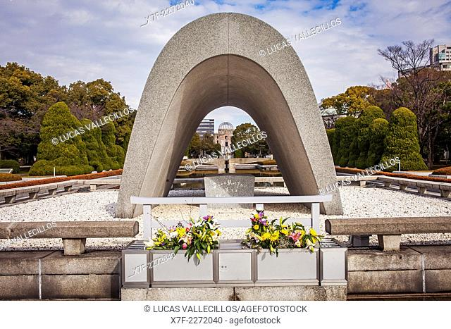 Cenotaph for the Atomic bomb victims, in background Atomic Bomb Dome, Peace Park, Hiroshima, Japan