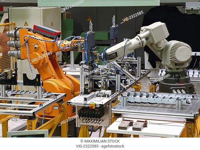 Assembly of a workpiece with two robots working in tandem operation, - 01/01/2010