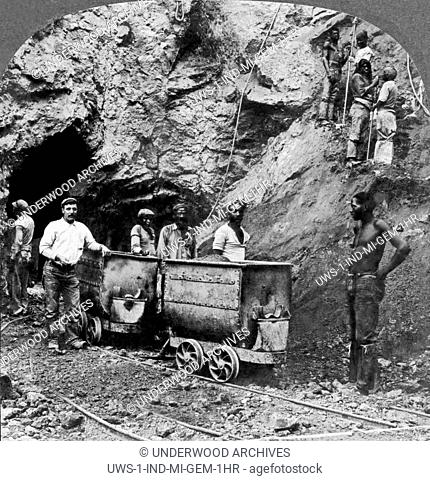 Kimberley, South Africa: c. 1900.Native black workers taking out the diamondferous blue earth that contains the diamonds in a mine at Kimberley in South Africa