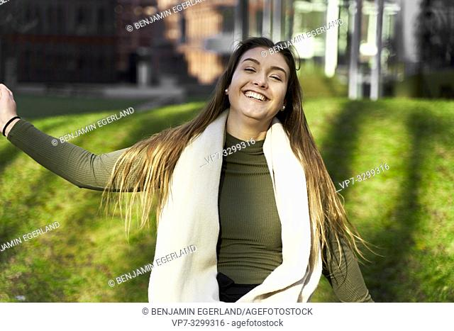 buoyant woman, outdoors at park in Hamburg, Germany