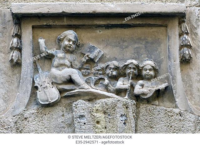 A XVth century sculpture of a music class and conducter over the lintel of a door in Pezenas, France