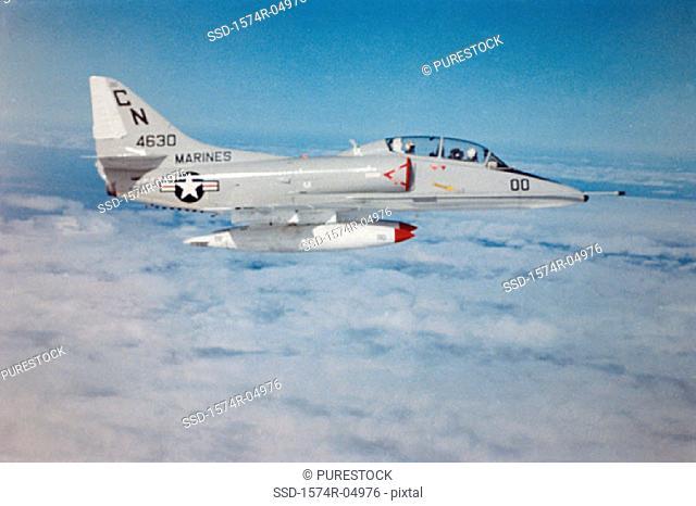 Side profile of an A-4 Skyhawk jet fighter in flight