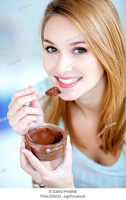 Woman eating a chocolate mousse