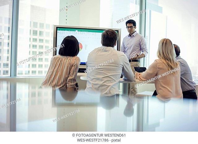 Business people listening to presentation