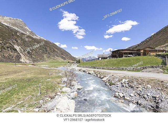 Alpine village of Davos on the shore of river Landwasser, Sertig Valley, canton of Graubünden, Switzerland