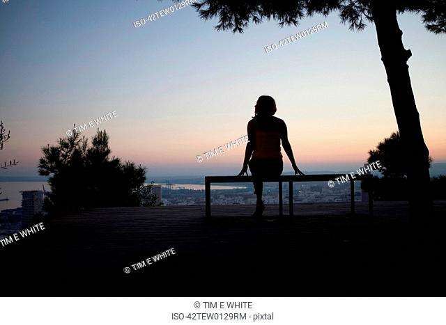 Woman admiring view from park bench