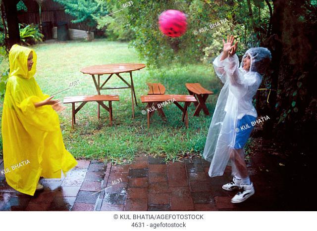 Pre-teen kids playing in the rain
