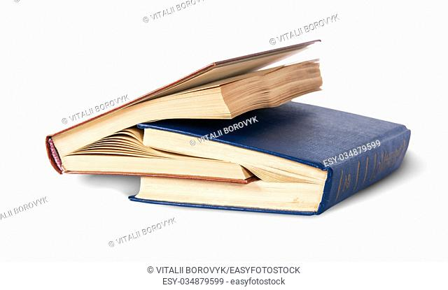 Two old books nested rotated isolated on white background