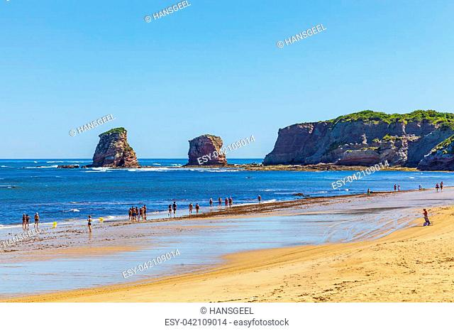 HENDAYE, FRANCE - JUNE 8: Tourists and surfers enjoy the beach of the charming seaside resort of Hendaye on June 8, 2017