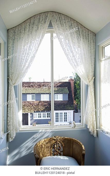 View of curtain on glass window at home; Balboa Island; California; USA
