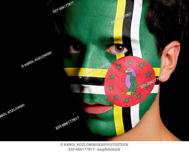 Flag of Dominica Painted on a Face of a Young Man
