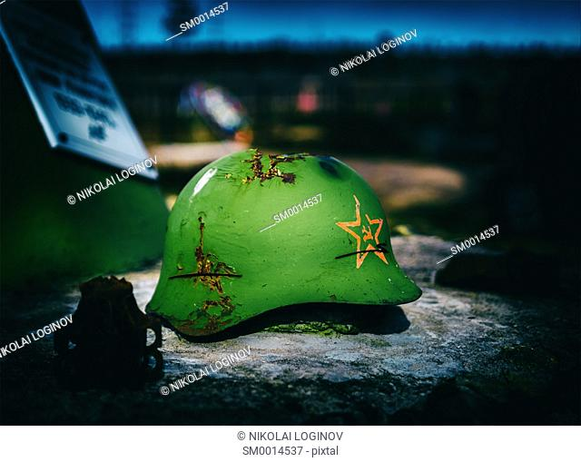 Horizontal vintage Soviet Army helmet battlefield closeup background
