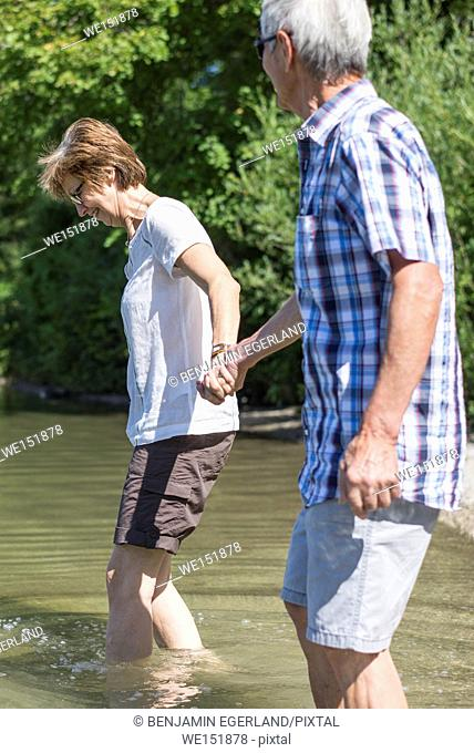 active senior couple having adventure in lake Kochelsee