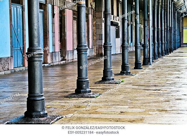 Columns in Hermanos Orbon Square, Aviles, Asturias, Spain