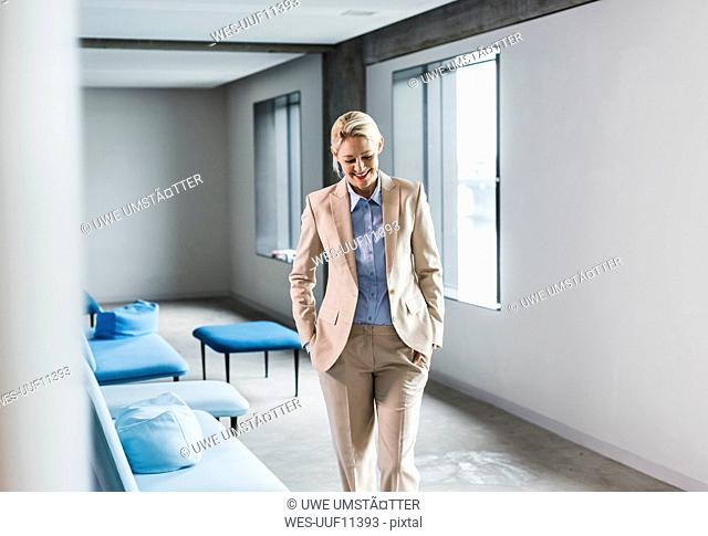 Smiling blond businesswoman