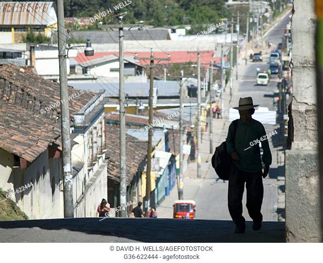 Traditionally dxressed Guatemalans walk on the streets in Chichicastenango, Guatemala