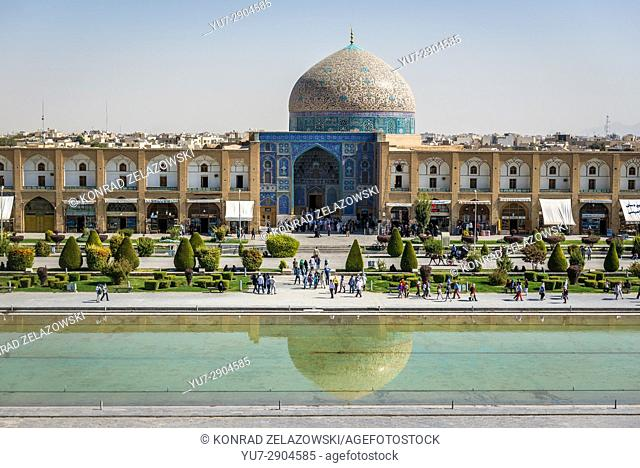 Pool at Naqsh-e Jahan Square (Imam Square, formlerly Shah Square) in centre of Isfahan in Iran. View with Sheikh Lotfollah Mosque
