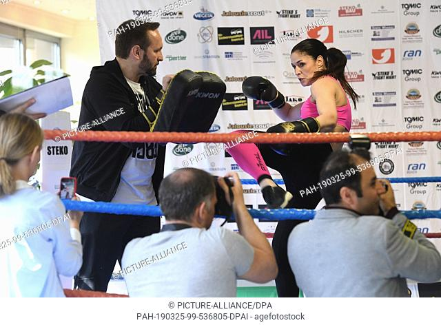 25 March 2019, Bavaria, München: The kickboxing coach Pavlica Steko and the kickboxing world champion Marie Lang can be seen at the press training of Stekos...