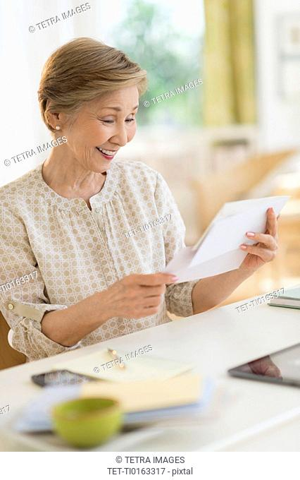 Senior woman reading letter