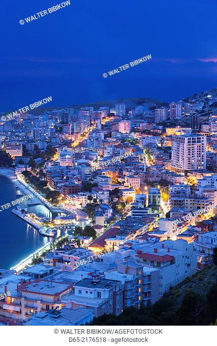 Albania, Albanian Riviera, Saranda, elevated city view, dusk