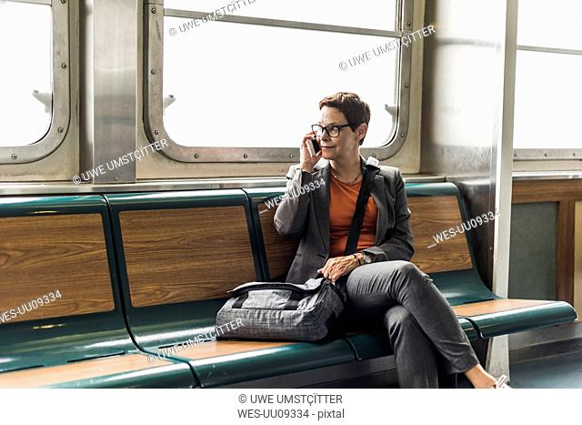 Businesswoman on a ferry on cell phone