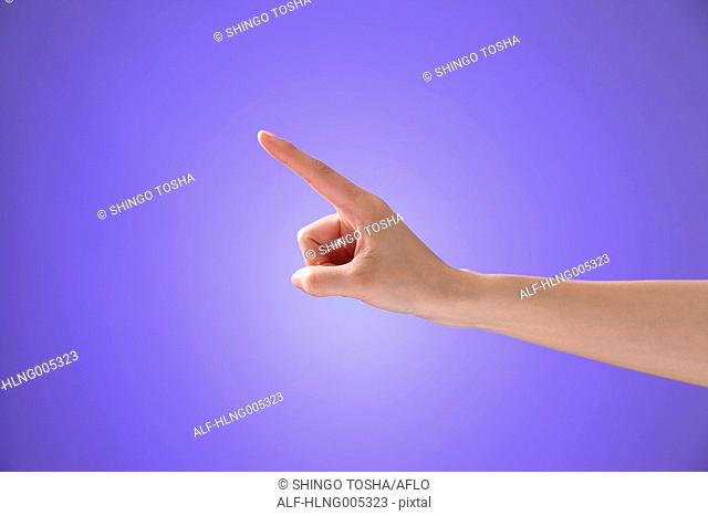 Female hand performing touch gesture