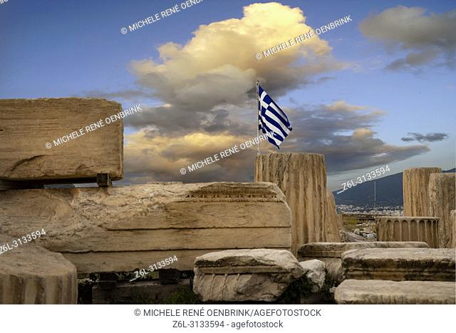 Ruins with Greek Flag flying located at The Parthenon or Temple of Athena on Athenian Acropolis in Greece