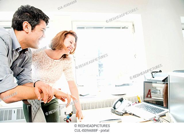 Office colleagues looking at computer