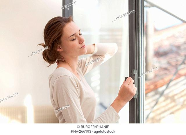 Woman opening window