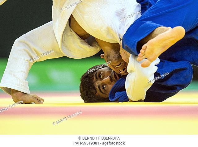 Beslan Mudranov (blue) of Russia competes with Orkhan Safarov of Azerbaijan in the Men's -60kg Judo Final at the Baku 2015 European Games in Heydar Aliyev Arena...