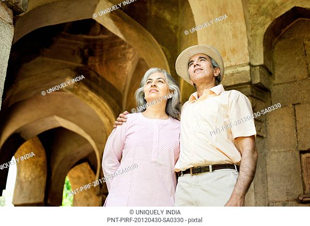 Mature couple standing at a monument, Lodi Gardens, New Delhi, India