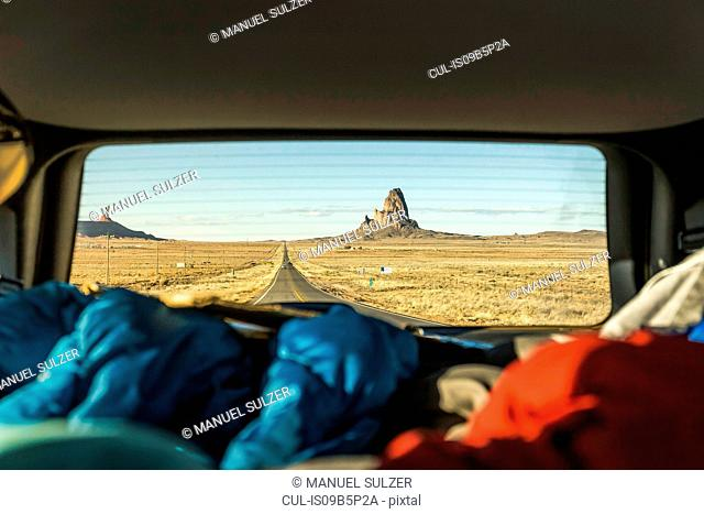 Landscape view with rock formations from vehicle window, Arizona, USA