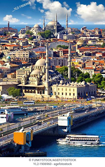 The Yeni Camii, The New Mosque or Mosque of the Valide Sultan foreground ordered by Safiye Sultan in 1597 on the banks of the Golden Horn and the Galata bridge