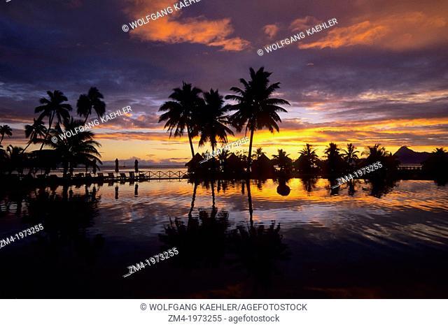 FRENCH POLYNESIA, SOCIETY ISLANDS, TAHITI, BEACHCOMBER HOTEL, SUNSET REFLECTING IN POOL