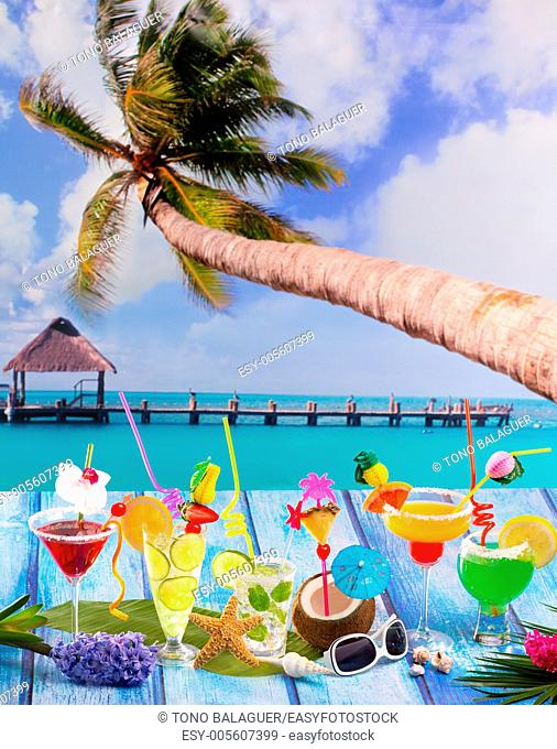 Beach colorful many tropical Cocktails in tropical blue wood with coconut mojito pepermint margarita and palm tree